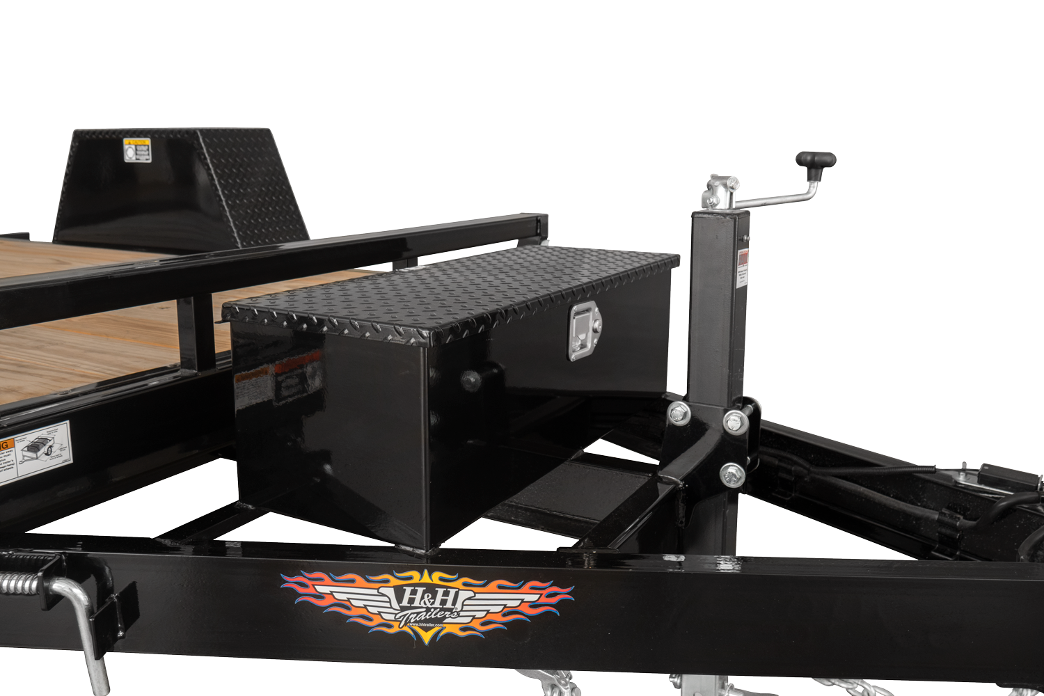 Use the tongue-mounted toolbox for storage on the Single Axle Gravity Tilt